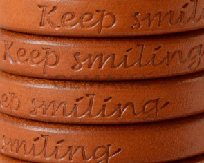 Cuero REGALIZ. Oval 10x6mm . Grabado. Keep Smiling. Camel. Calidad superior