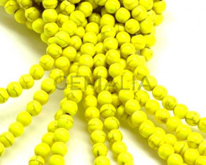 Turquesa sintetica.Bola 6mm.Amarillo fluor.Int.1mm aprox.