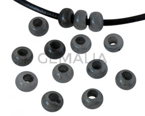 Resin rondell 6.5x6.5x4mm. Opaque grey. Inn.3mm aprox. Best Quality.